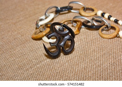 Indian jewelry with the OM symbol on the background burlap