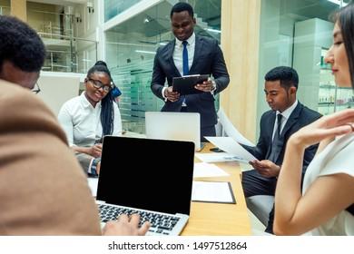 indian ,korean , afro-american businessman businesswoman work in modern background