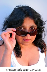 Indian lady peers over her sunglasses