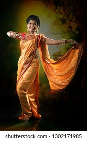 Indian lady performing Maharatrian folk dance called Lavani