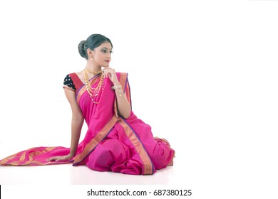 Indian Lady in traditional saree in seat pose
