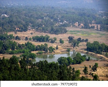 Indian landscape aerial view of rural village pond with trees jungle field house