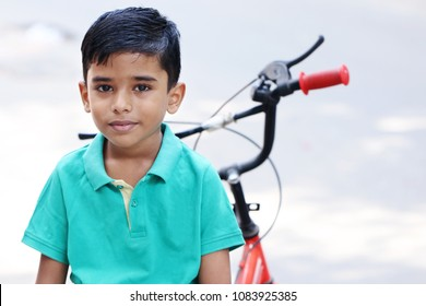 Indian Little Boy with Cycle