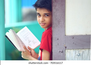 Indian Little Boy with Textbook