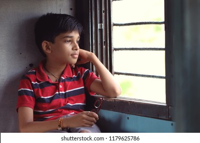 Indian Little boy traveling in train