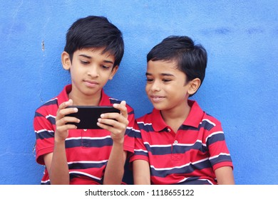 Indian Little Brothers with Mobile Phone