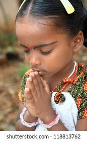 Indian Little Girl Praying