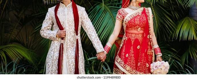 Indian lovebirds couple holding hand outdoor photo shoot