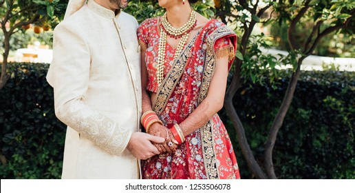 Indian lovebirds couple holding hand at their wedding day