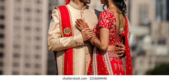 Indian Lovebirds couple hugging and Groom holding bridal hand first-look for wedding day