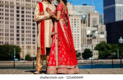 Indian Lovebirds couple hugging and Groom holding bridal hand first look for wedding day