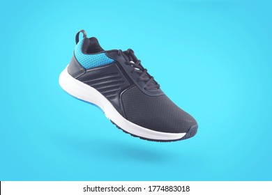 Indian made men's Sports Shoes Isolated on Blue Background