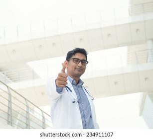 indian male doctor celebrating success , slight vintage tone