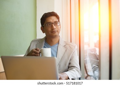 indian male drinking coffee