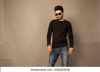 Indian Male Model in Black TShirt & Blue Denim and Black Sunglasses