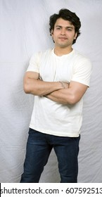 indian male model in white tshirt folding hands