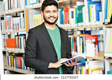 Indian male student at the library