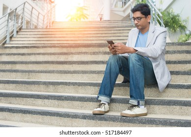 indian male using phone