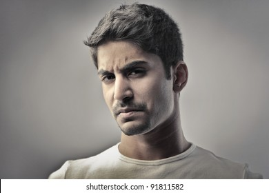 Indian man with angry expression