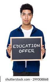 Indian man with chalkboard showing education offer