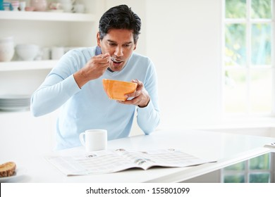 Indian Man Enjoying Breakfast At Home
