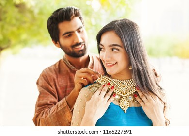 Indian man gifting jewelry to his bride