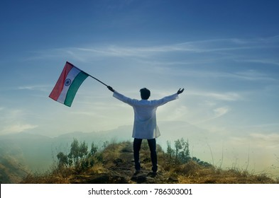 Indian Man holding indian flag on top of mountain, independence day, republic day.