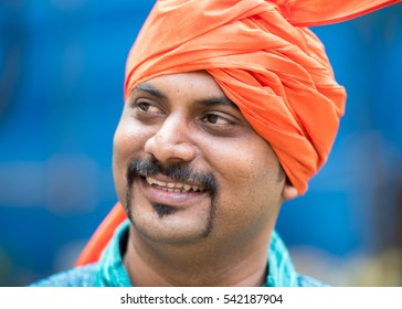 Indian man with orange turban on Diwali Festival, Mumbai, Maharashtra, India, Southeast Asia.