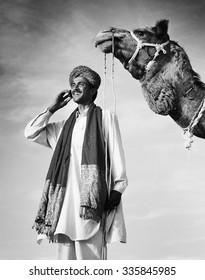 Indian Man Phone Camel Communication Technology Concept