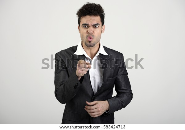 Indian man pointing at you