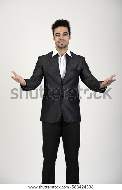 Indian man presenting something with open arms
