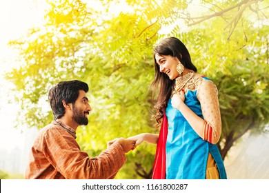 Indian man proposing to his bride