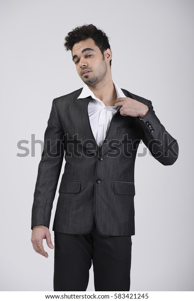 Indian man pulling collar feeling suffocated
