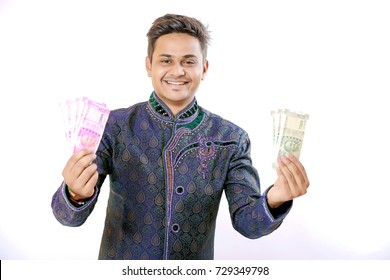 Indian man showing indian currency note