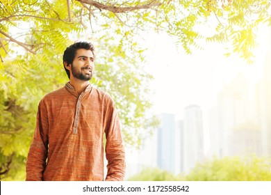 Indian man walking in a city park in the morning