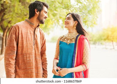 Indian man and woman in traditional clothes talking to each other