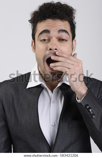 Indian man yawning
