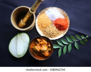 Indian mango pickle with Indian spices, red chili powder, fenugreek seeds, salt and mustard seeds powder and curry leaves