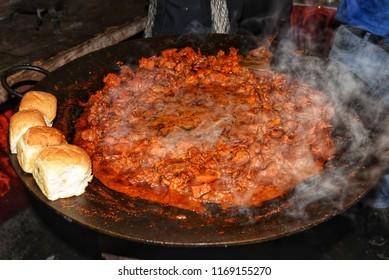 Indian Masala Kheema Pav or Khima or dry spicy minced meat usually served with bread, street food in Indian Ramadan market in Shivaji Nagar Bengaluru. Muslim big food festival Iftar party.