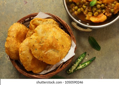 Indian Masala Poori / Puri served with Aloo Mutter , selective focus
