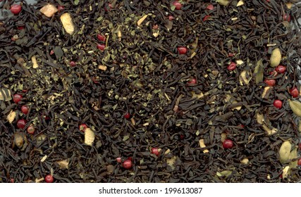 Indian masala tea with pink peppercorn as background