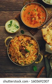 Indian meal / Restaurant menu concept - Mutton biryani, butter chicken, Roti and raita background