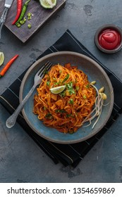 Indian mee goreng or mee goreng mamak, Indonesian and Malaysian cuisine, spicy fried noodles in a plate, top view