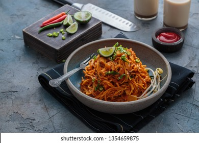 Indian mee goreng or mee goreng mamak, Indonesian and Malaysian cuisine, spicy fried noodles in a plate, copy space