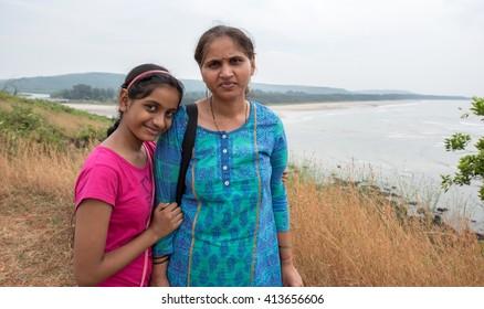 Indian mother and daughter at Arrey-Warrey beach coastal road between Ganapatipule and Ratnagiri, Konkan, Maharashtra, India, Southeast Asia.