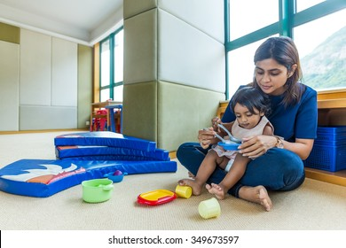 Indian mother play with her daughter at home
