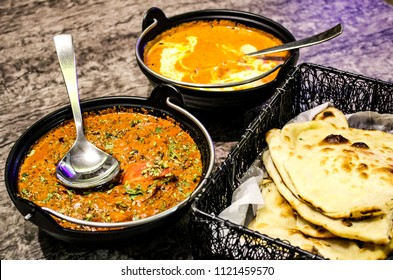Indian mouthwatering cuisine! Butter Naan with Daal makhani and paneer butter masala.