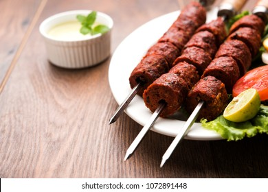 Indian Mutton Seekh Kabab served with green salad, selective focus