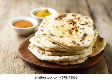 Indian naan bread on wooden desk