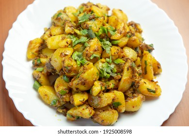 Indian Nepali Style Aloo or Alu Fry Recipe served on a plate. Potato Fry, Boiled and fried potato recipe.Selective focus